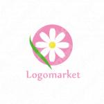 花と円とピンクのロゴ