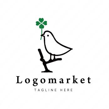 鳥とクローバーとイラストのロゴ