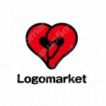 ボクシンググローブとハートと心臓のロゴ