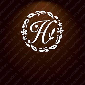 Hと飾り罫と女性らしいのロゴ